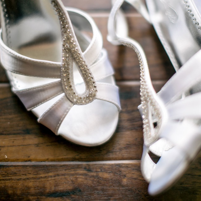 Gabby walked down the aisle in a pair of white t-strap sandals with rhinestone accents for a hint of shimmer.