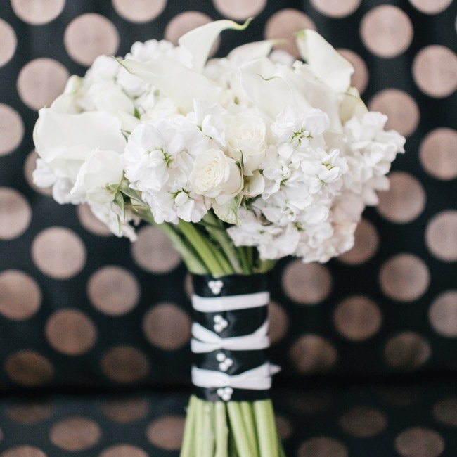 To contrast with her black gown, Ashley carried a bouquet of bright white calla lilies, stock and roses. The bouquet was tied with a black and white bouquet wrap accented by clusters of pearl pins.