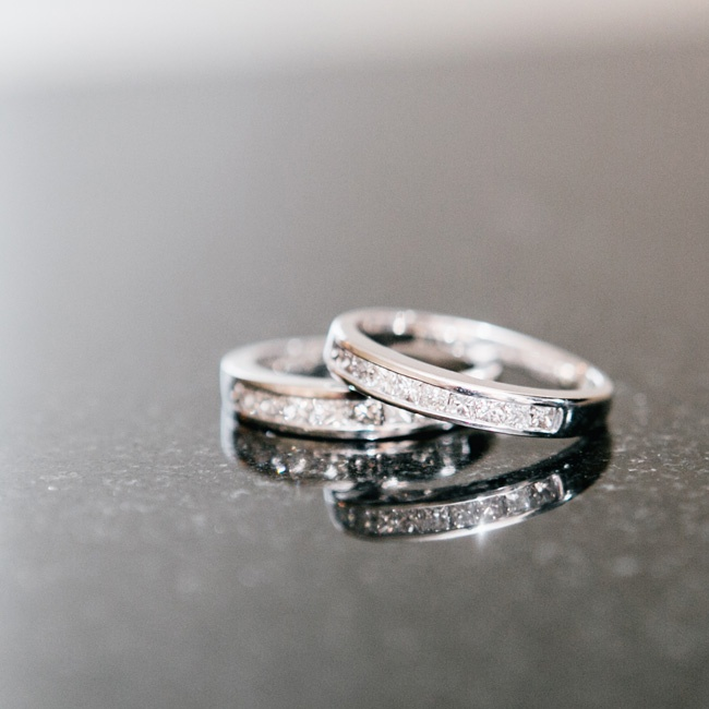 For their wedding, Ashley and Gabby exchanged the diamond bands they had given to each other when they became domestic partners in 2006. They added an extra special touch to the rings, engraving their wedding date on the inside of each ring to symbolize new beginnings and the continuation of their journey as a couple.