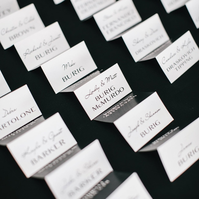 The escort cards had a simple, contemporary look with mixed modern and script fonts in a black and white color palette.