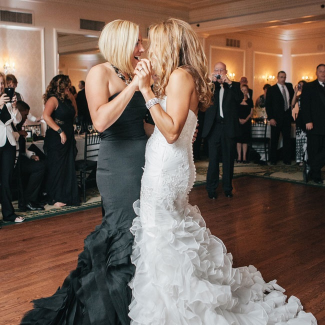 "Ashley and Gabby had their first dance to ""No Greater Love"" in the style of Amy Winehouse."