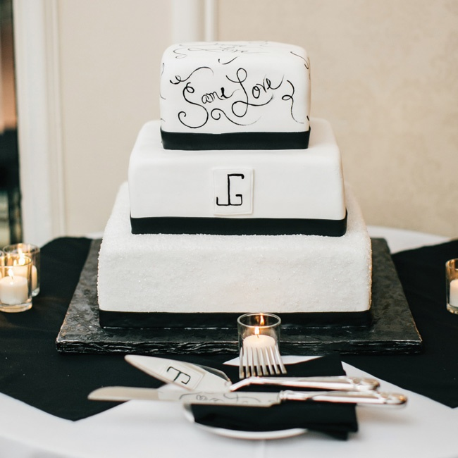 "The couple added a special touch to their modern black and white fondant cake; the top layer was decorated with handed painted love phrases like ""Same Love."""