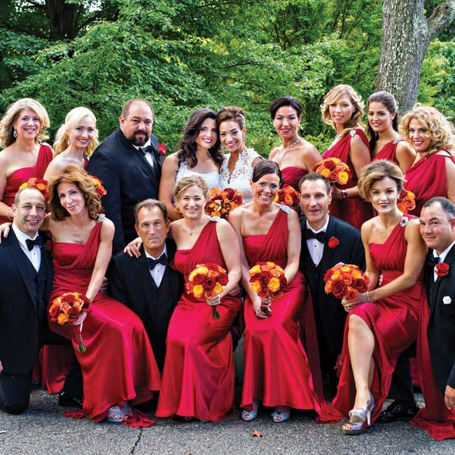 Carla and Margaret's bridesmaids wore floor length satin gowns in a deep berry color. The elegant one-shoulder gowns were accented by a crystal brooch at the shoulder.