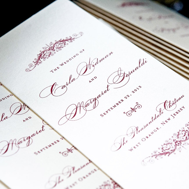 The couple infused their invitations with classic old world charm, using elegant script and floral, rococo design.