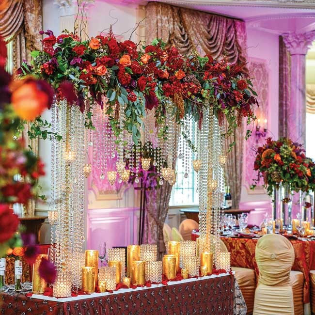 A Touch of Elegance custom designed an extravagant sweetheart table for the newlyweds. The table was decorated with hanging crystals, a lush floral garland that matched the one on their huppah, rose petals and gold mercury glass pillar candles for a dramatic, whimsical look.