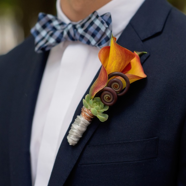 Tommy and Kyle wore orange boutonnieres of succulents, fiddlehead ferns and calla lilies.