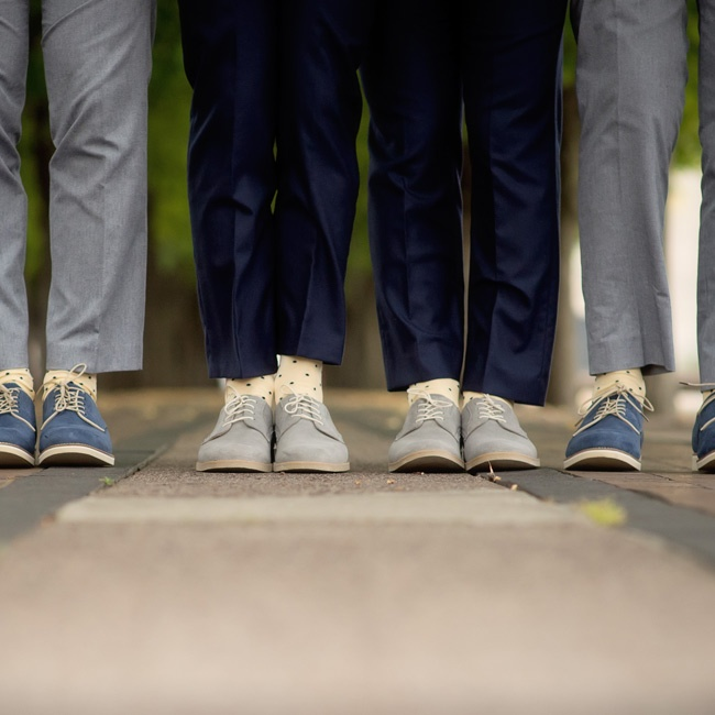 Tommy and Kyle stood out from their groomsmen with light sneakers and dark suits. Their attendants wore gray suits with darker shoes.