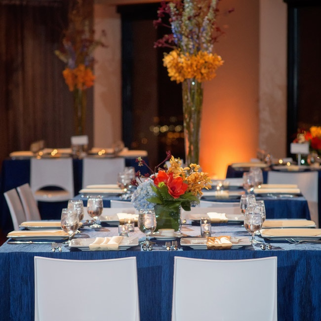White chairs and blue tablecloths made clean, modern lines at the reception.