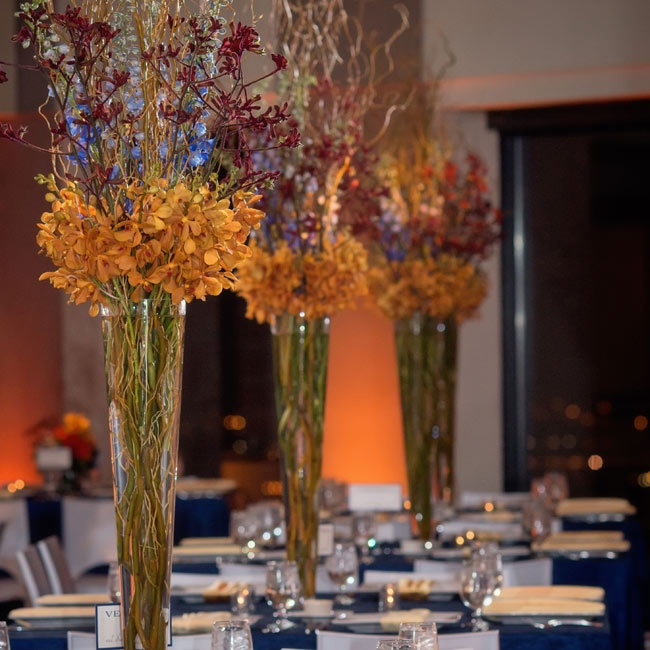 Tall centerpieces filled with orange hydrangeas and vines caught guests eyes as they entered the reception space.