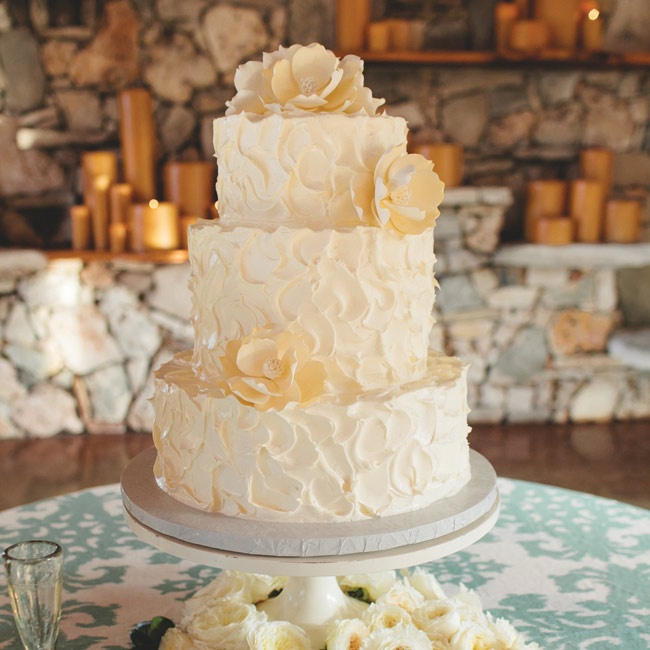 The cake was classic white, but each tier had a different filling, including strawberries and cream, dulce de leche and vanilla. It was decorated with large sugar magnolias on the tiers.