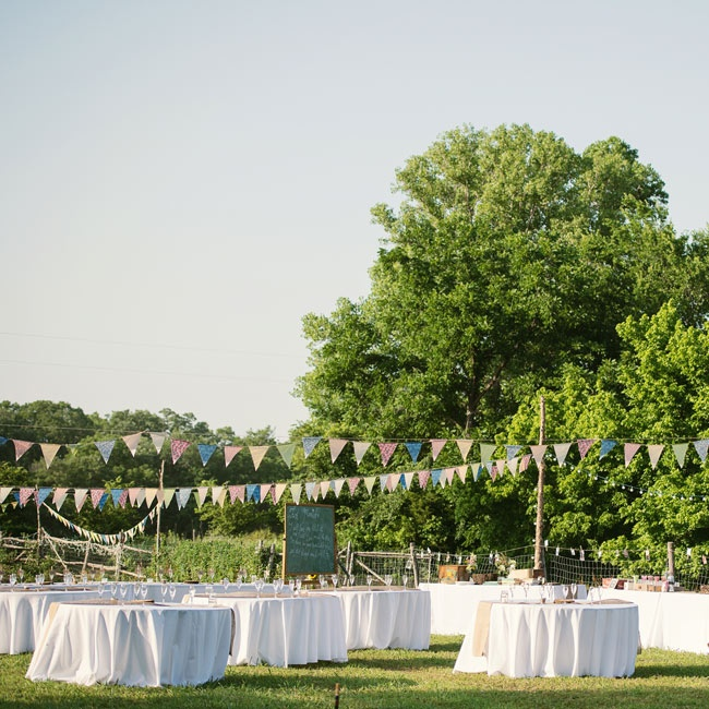 The reception was set up using DIY elements such as jars filled with homemade jam and banners strung throughout to give off the laid back aura of guests being at a fair.