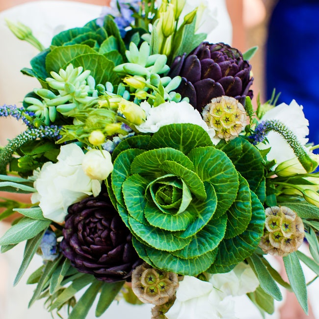 Kale and artichoke mingled with scabiosa pods and budding tulips in the bridal bouquet.