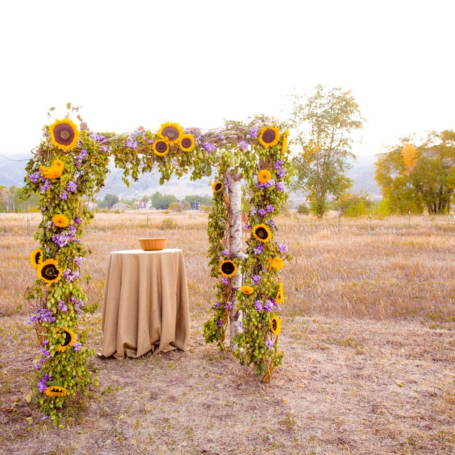 The ceremony arch was a framed pergola lined with an arrangement of sunflowers and lavender.