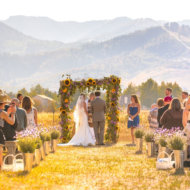 As guests watched Lindsay and Ryan wed, they had a beautiful view of mountains in the distance.