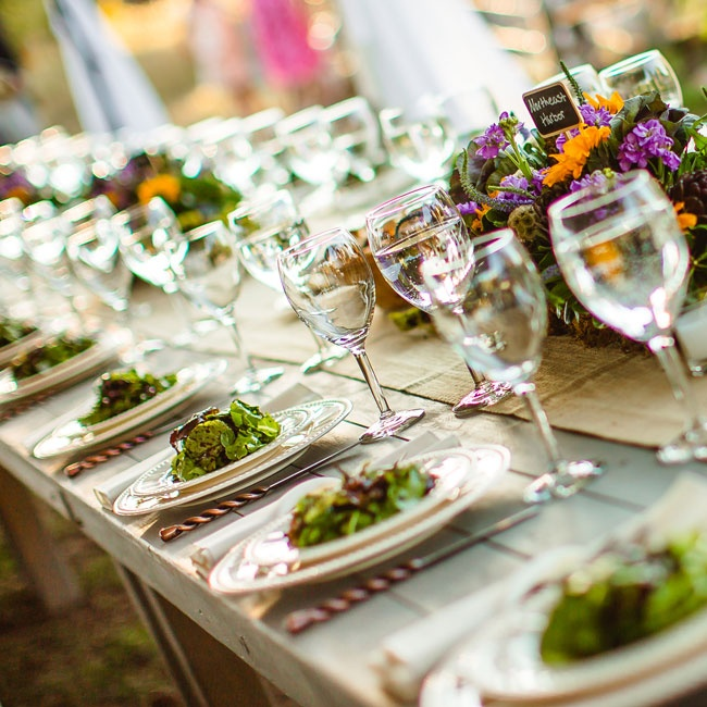 Sunflower and lavender floral arrangements lined the rustic wooden farm tables at the reception.