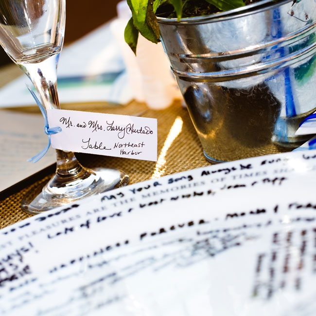 Place cards were tied around each guest's wine glass at the reception dinner.