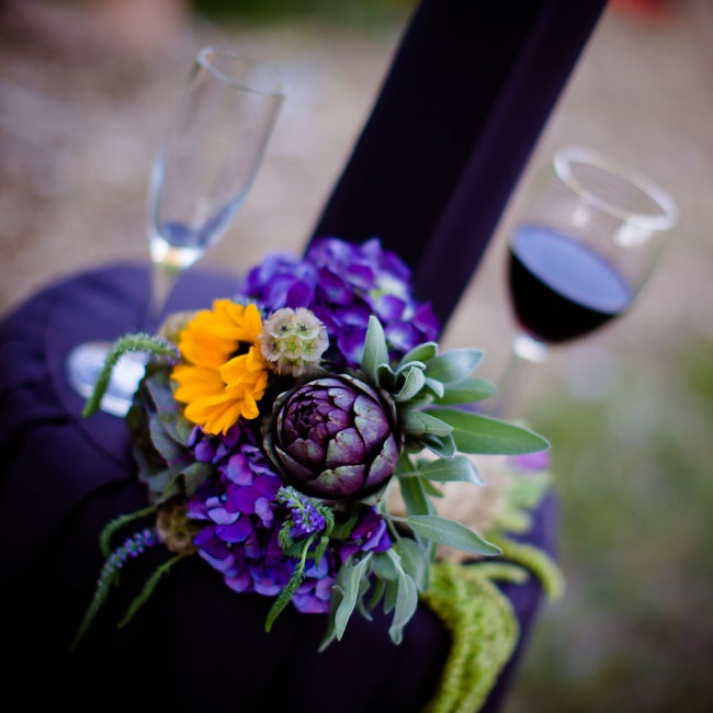 Artichokes, sunflowers, scabiosas and hydrangeas made for artful centerpieces during cocktail hour.