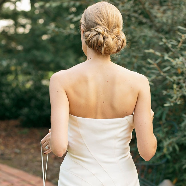 Laura wore her hair in a simple loose updo. The tucked style sat low, at the nape of her neck.