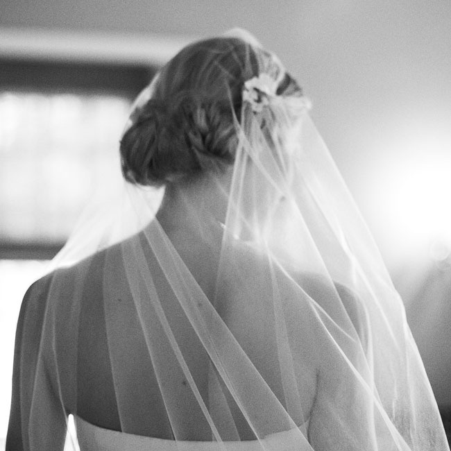 For a timeless look, Laura wore a veil during the ceremony that was made by her mother with pieces of lace from her own veil and had also been worn by Laura's aunts and three sisters.