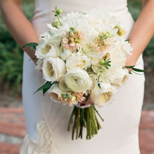 Laura kept her bouquet simple with garden roses, lisanthius, dahlias, ranuculus and spray roses in soft shades of ivory, white and blush accented with seeded eucalyptus.