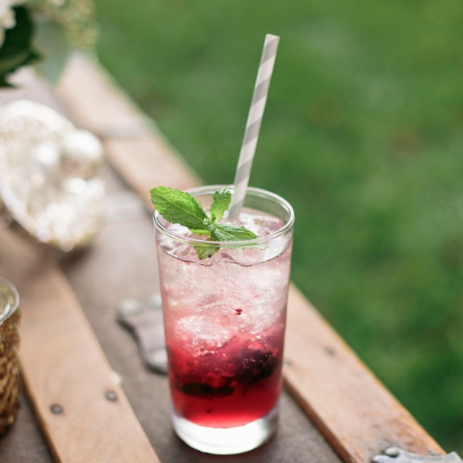 """Laura and Kyle's signature drink was a """"Blackberry Crush."""" The cocktail combined prosecco, vodka, muddled blackberries, sour mix and blackberry syrup garnished with a sprig of fresh mint."""