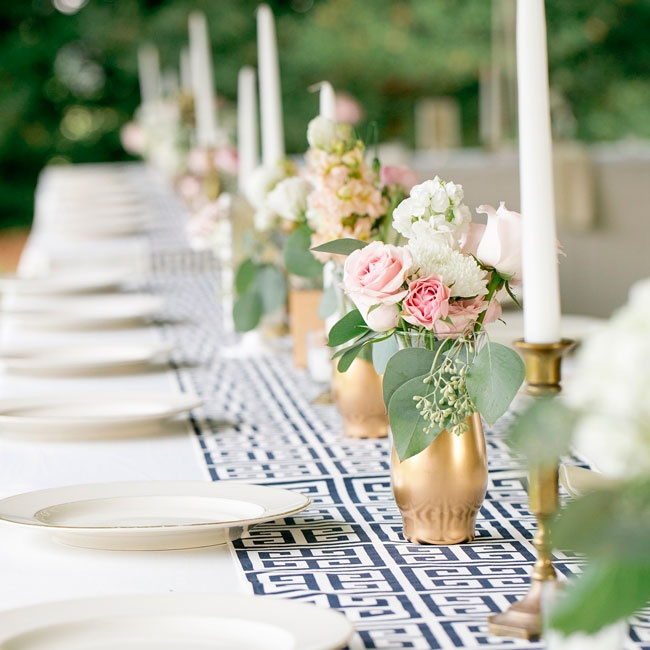 Bunches of roses, dahlias and stock accented by seeded eucalyptus filled small golden vases for elegant centerpieces with a romantic touch.
