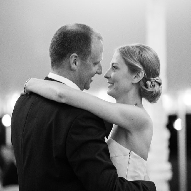 Laura and Kyle had their first dance as friends and family looked on.