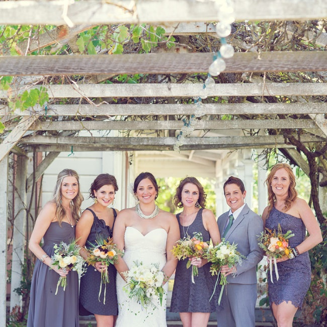 Nikki's bridesmaids wore mismatching lavender bridesmaid dresses in various styles and fabrics.