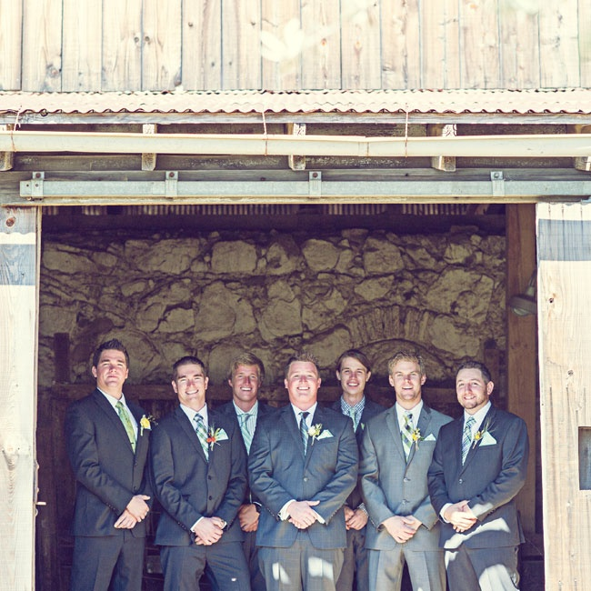Groomsmen wore charcoal suits with mismatching green and blue ties.