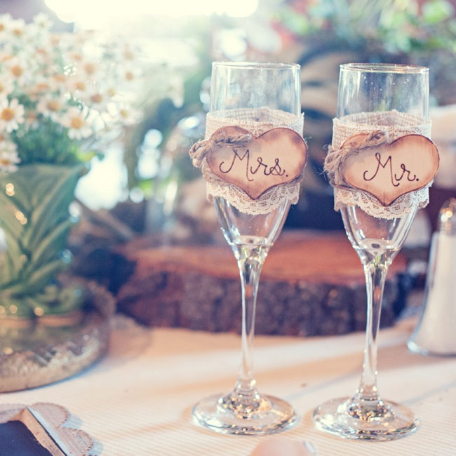 "The bride and groom's champagne flutes were lined with lace and heart signs that read ""Mrs. and Mr."""