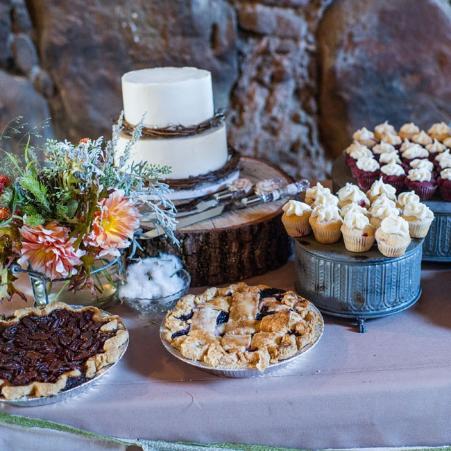 An array of desserts, including cake, cupcake and pies were laid out on a table at the reception.