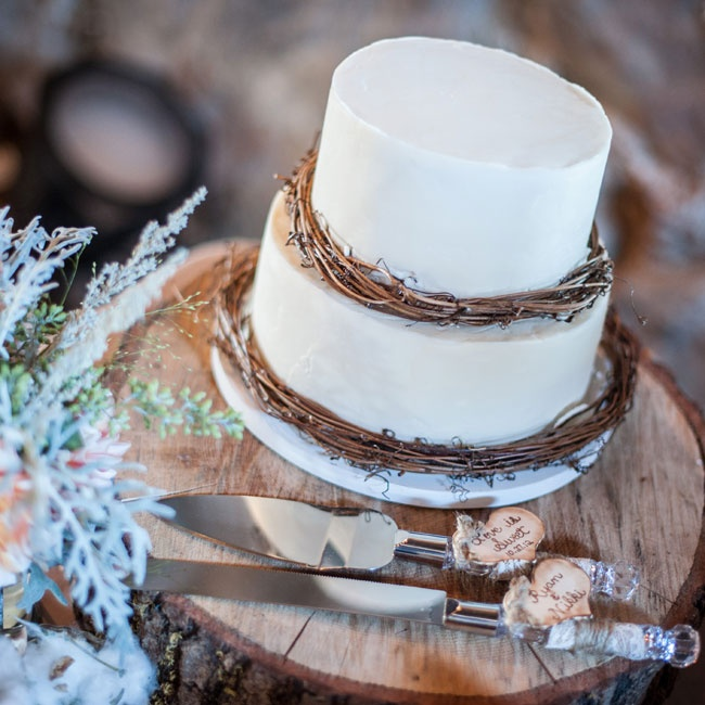 The couple's wedding cake was a simple two-tiered, round, white cake accented with rustic twigs.