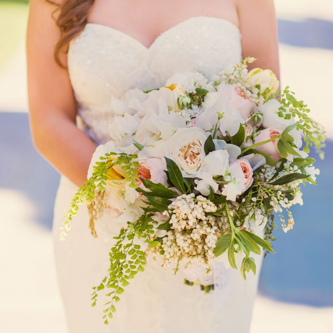 The bride carried a bouquet of white peonies, roses and hypernicum berries down the aisle.
