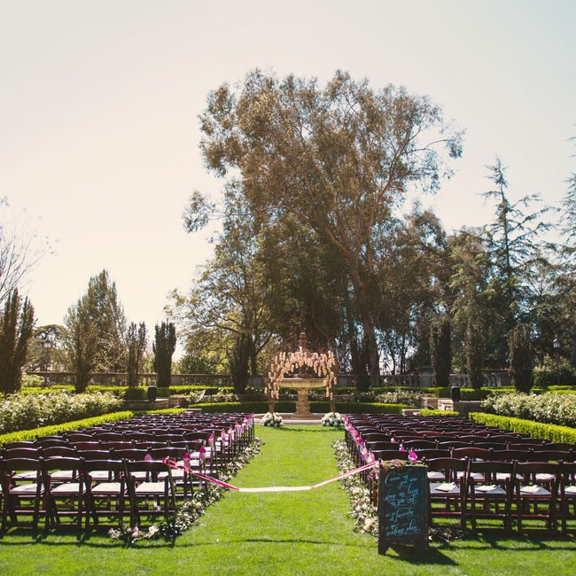 Since French gardens were Elizabeth's inspiration, the outdoor ceremony had to be light and romantic.