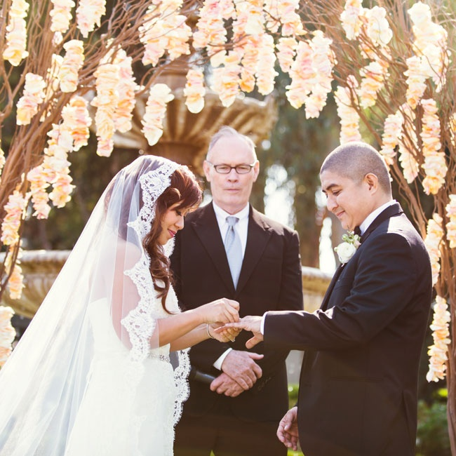 Hanging peach floral garlands were hung from the tree branch ceremony arch.