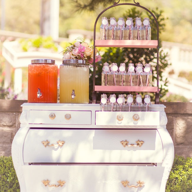 Refreshments were set out on this vintage-inspired white dresser.