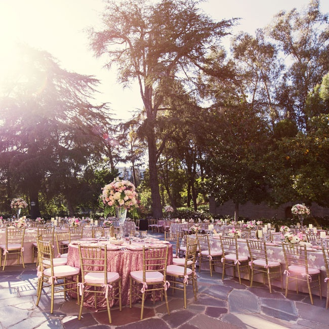 Blush and gold mixed together on the stone patio of Greystone Mansion.