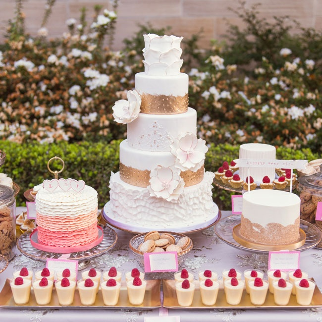 The couple's wedding cake was designed with golden accents and pink ombre ruffles.