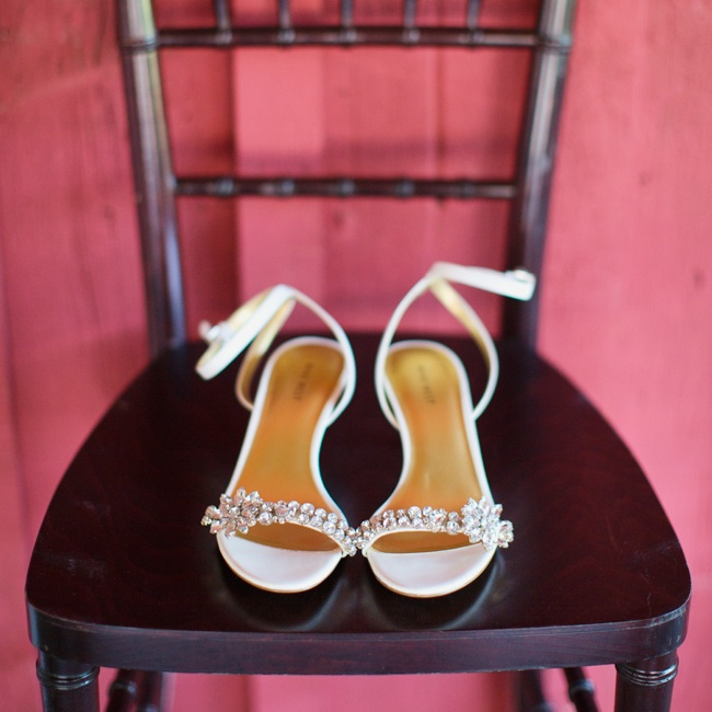 Carrie walked down the aisle in comfort in these embellished, white bridal sandals.