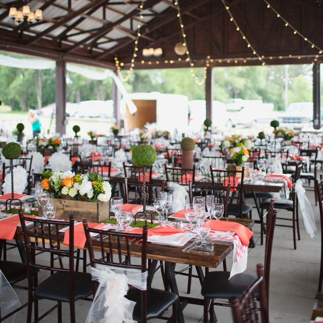 Guests dined in a pavilion area with fun lighting and coral linens.