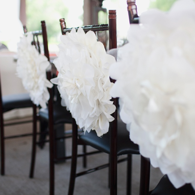 Paper dahlias decorated the backs of the dark Chiavari chairs at the reception.