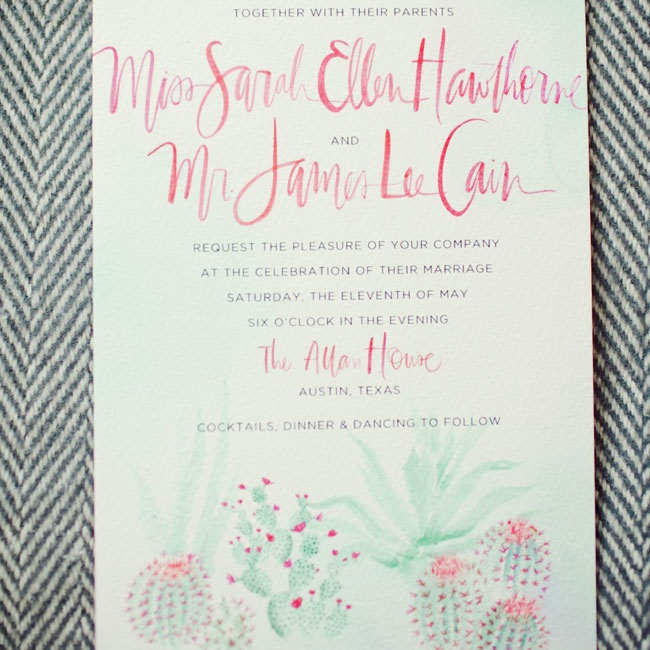 The couple worked with their stationery designer to create gorgeous watercolor invitations decorated with flowering succulents in shades of light green and coral.