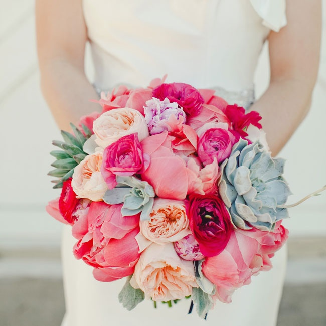 """My bouquet was my favorite accessory of the whole weekend,"" says Sarah. It was a vibrant combination of coral and pink peonies, garden roses and ranunculuses, accented with succulents and dusty miller."