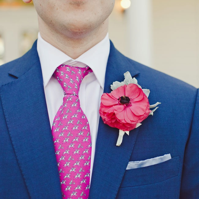 Lush open ranunculuses were paired with dusty miller on the men's lapels.