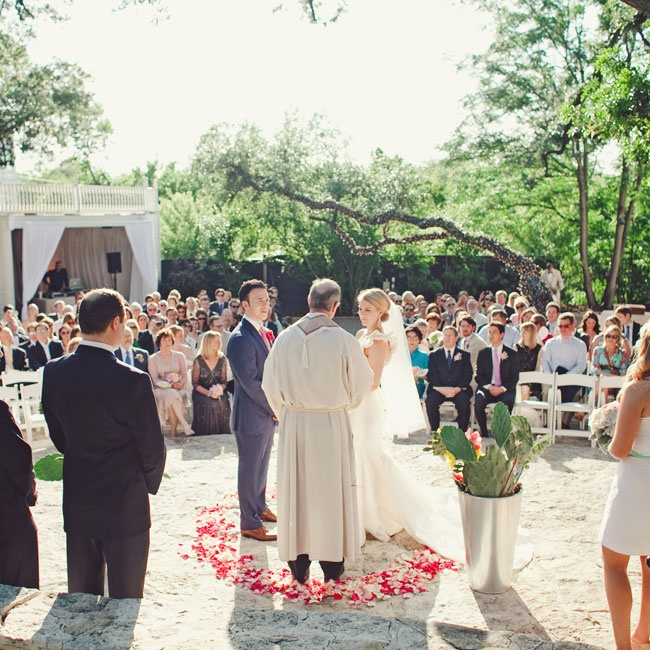 Sarah and James were married in the courtyard of The Allan House, surrounded by a ring of bright pink flowers and all of their loved ones.