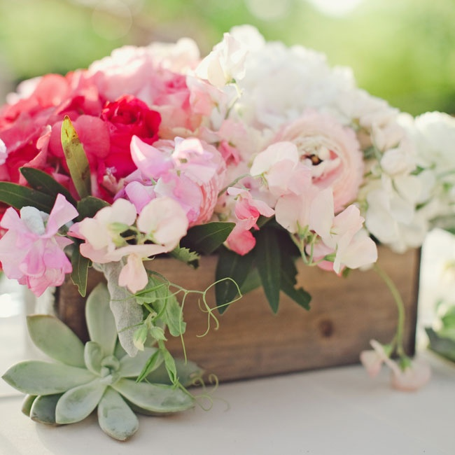 Weathered wood boxes filled with hydrangeas, roses and ranunculuses topped some of the tables at the reception.