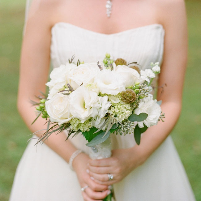 Lauren carried a bouquet of ivory lisisanthuses, roses, hydrangeas and stock flowers with rustic accents like scabiosa pods, grasses and seeded eucalyptus.