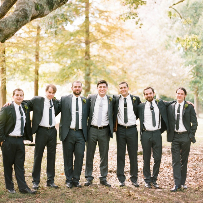 Zach and his groomsmen wore matching gray J. Crew suits with crisp white button ups and skinny ties.