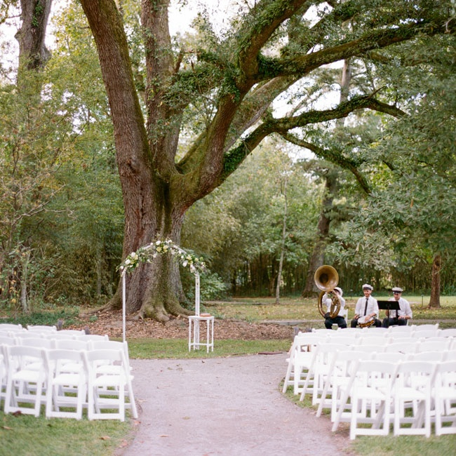 The simple ceremony too place outdoors under the canopy of a large tree.