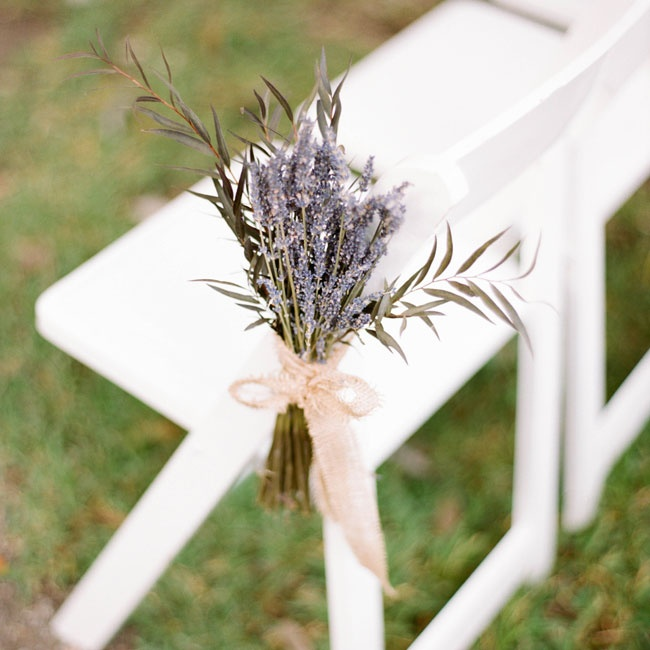 Bundles of lavender and olive leaves tied together with burlap ribbon marked the ceremony aisles.